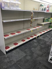 Empty shelves where the toilet paper should have been at a CVS store in Mesa.