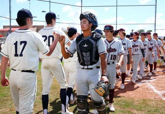 The Copper Hills Grizzlies (Utah) players congratulate the winning Hamilton Huskies (right) following their 5-2 loss during the Borras Classic played at Corona del Sol High School on Mar. 14, 2020 in Tempe, Ariz.