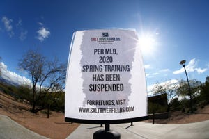 A sign announces that Major League Baseball has suspended the 2020 spring training season, this is in response to the COVID-19 virus health emergency on March 13, 2020 at Salt River Fields at Talking Stick in Scottsdale.