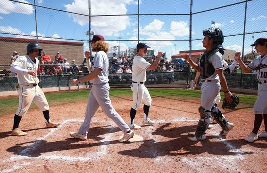 The Copper Hills Grizzlies (Utah) players congratulate the winning Hamilton Huskies (gray uniforms) following their 5-2 loss during the Borras Classic played at Corona del Sol High School on Mar. 14, 2020 in Tempe, Ariz.