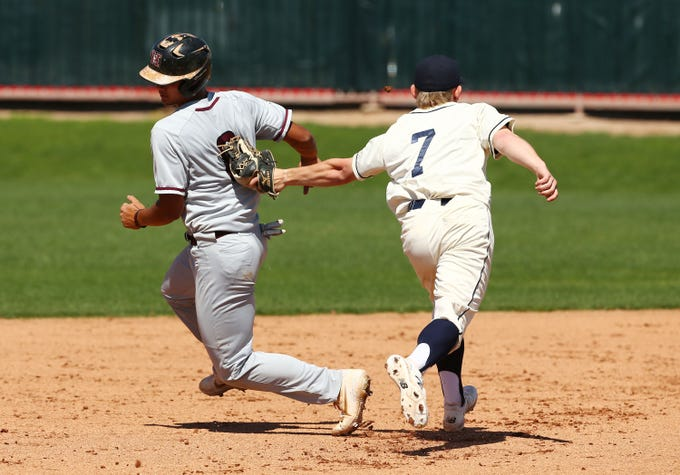 Copper Hills Grizzlies (Utah) pitcher Cameron Ostmark (7) tags-out Hamilton Huskies Tyler Wilson (8) in the second inning during the Borras Classic played at Corona del Sol High School on Mar. 14, 2020 in Tempe, Ariz.