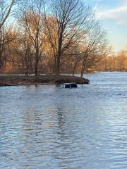 Two people were rescued after a Jeep failed to make it across the water to a nearby island and sunk in East Manchester Township Friday night, police said.