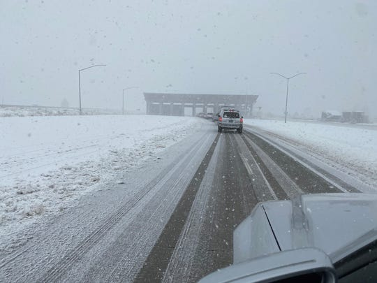 A photo of snow falling over Interstate 80 near Truckee on March 14, 2020.