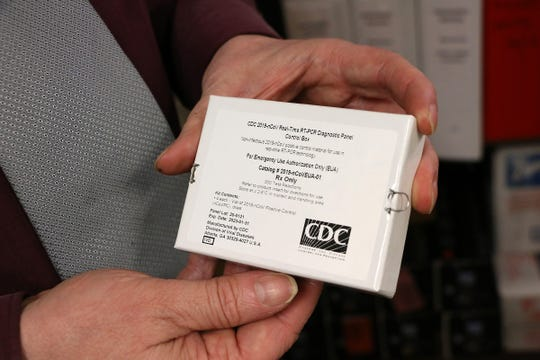 Director Mark Pandori holds a test kit for COVID-19 at the Nevada State Public Health Lab in Reno on March 13, 2020.