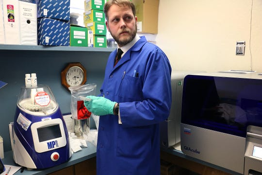 Dr. Andrew Gorzalski tests samples for COVID-19 at the Nevada State Health Laboratory in Reno on March 13, 2020.