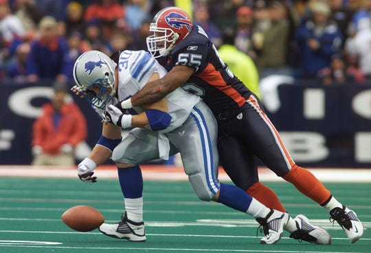 Buffalo Bills linebacker Eddie Robinson breaks up a pass intended for Lions fullback Cory Schlesinger on a key fourth down on Oct. 27, 2002.