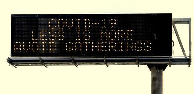 A sign above Highway 299 near the Churn Creek Road exit in Redding warns of coronavirus exposure on Saturday, March 14, 2020.