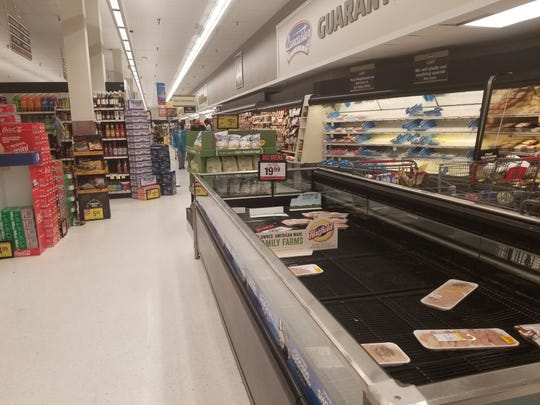 Nearly empty chicken shelves at a Salisbury store.