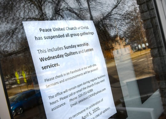 A sign posted on the door of Peace United Church of Christ is pictured Saturday, Marc 14, 2020, in St. Cloud.