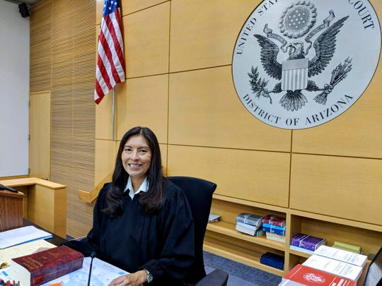 In this Jan. 17, 2020, photo, U.S. District Court Judge Diane Humetewa sits in her chambers at the federal courthouse in Phoenix. Humetewa, who is Hopi, is one of only three Native Americans who have served as federal judges and is the first Native American woman to do so. (Patty Talahongva/Indian Country Today via AP)