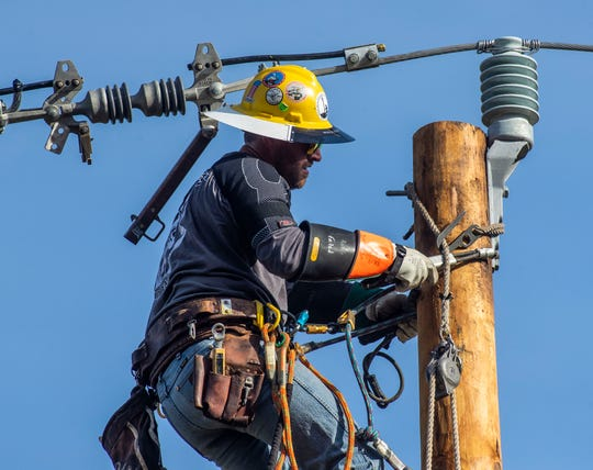 File art of an electric lineman.