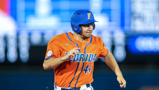 Florida outfielder Austin Langworthy (44) runs to third during an NCAA baseball game against Florida A&M on Wednesday, March 4, 2020, in Gainesville, Fla. (AP Photo/Gary McCullough)