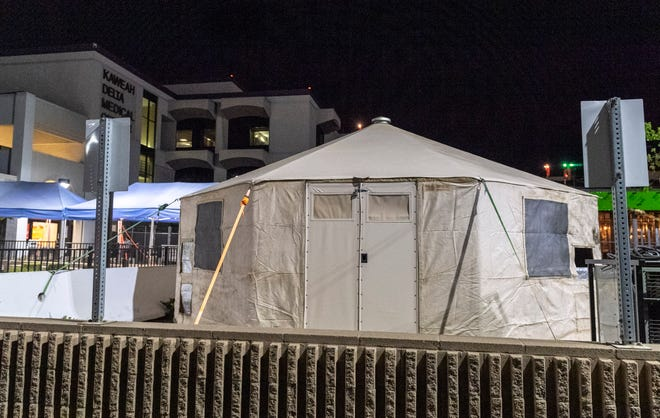 A temporary tent is in place outside Kaweah Delta Medical Center on Friday, March 13, 2020.