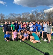 Ciara Durcan (center, standing with white shirt) is joined by her Pearl River girls track teammates, who were part of a group of athletes who cheered her on while  she racewalked Friday.