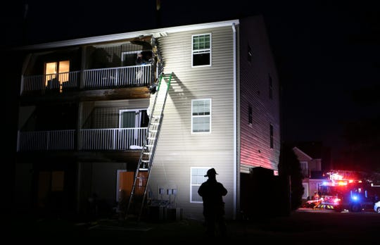 Firefighters work after extinguishing a blaze on the third floor of an apartment at Sophia's Place West near New Castle, reported shortly after 7 p.m. Friday. Three apartment units on Highlands Blvd. were impacted by the fire, which was declared under control in less than half an hour.
