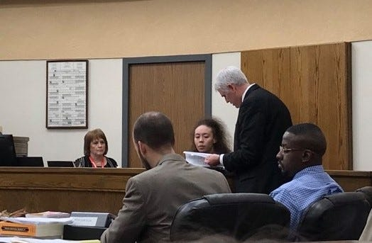 Wichita County District Attorney John Gillespie questions Shantalle Shabrea Vallier Friday during Jermar Fuller's capital murder trial. Fuller is seated, right.