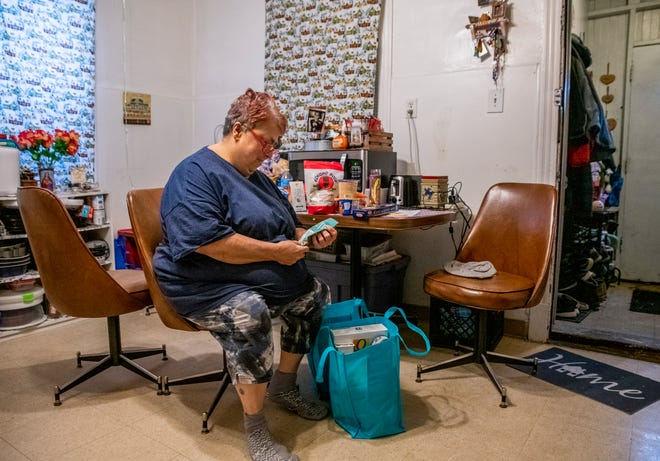 Rose McDonough sorts through donations delivered to her door in March in Chicago. Her son Michael McDonough Jr. is a student at Vaughn Occupational High School, the first Chicago school to shut down because of the pandemic.