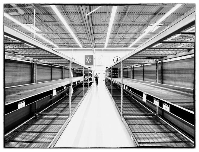 Empty shelves at a Walmart in Gardena, California at 9:30 a.m. on March 13, 2020, that had been full of paper towels and toilet paper just a few hours earlier