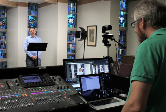 John Bolden, right, engineers the livestreamed sermon Sunday by Aldersgate UMC pastor Dustin Wilhite from the church's chapel. Sunday services were canceled Saturday and members were texted to join the Facebook service instead.