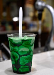 A green-colored ice cream drink sits on the bar at Old Doc's Soda Shop in Dublin Saturday.