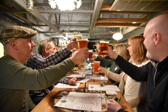 Participants in the 'Luck of the Irish Marshall Trolley Beer Tour in Marshall, Mich. on Saturday, March 14, 2020.
