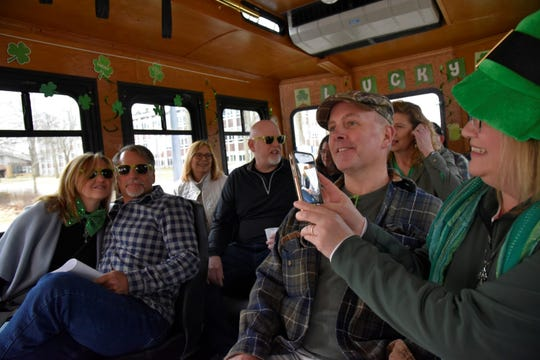 (L-R) Jodi Lubis, John Lubis, Katrina Aasselin, Brad Asselin, Jeff Fitzmaurice and Joanne Fitzmaurice ride on the 'Luck of the Irish Marshall Trolley Beer Tour in Marshall, Mich. on Saturday, March 14, 2020.