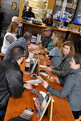 A group makes the first stop during the 'Luck of the Irish Marshall Trolley Beer Tour' at Albion Malleable Brewing in Albion, Mich. on Saturday, March 20, 2020.