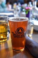 A glass of Grand River Union Juice at Grand River Brewery in Marshall, Mich. on Saturday, March 14, 2020.