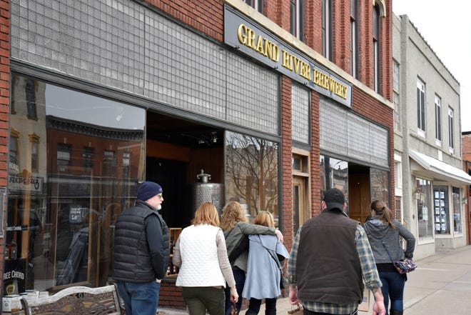 A group with the 'Luck of the Irish Marshall Trolley Beer Tour' walks in to Grand River Brewery in Marshall, Mich. on Saturday, March 14, 2020.