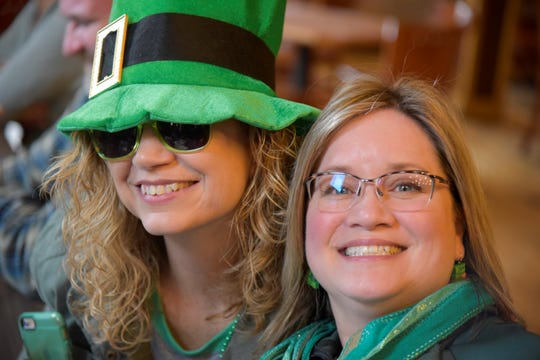 Kim Hunt of St. Clair Shores and Joanne Fitzmaurice of Marshall smile for a photo inside Grand River Brewery in Marshall, Mich. on Saturday, March 14, 2020.