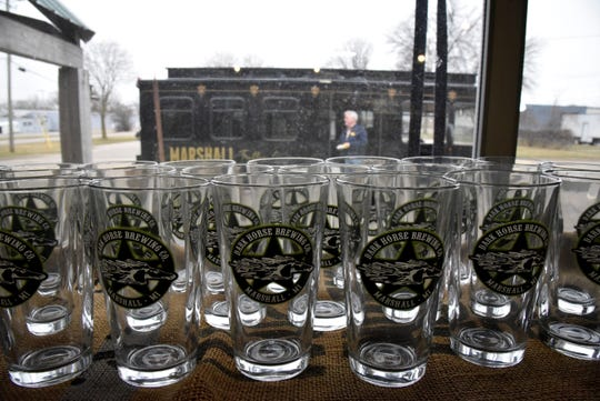 """The Marshall Trolley Company trolley sits parked outside Dark Horse Brewing Co. during the 'Luck of the Irish Marshall Trolley Beer Tour"""" in Marshall, Mich. on Saturday, March 14, 2020."""