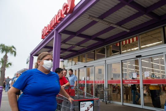 People wait in line at the HEB on Saratoga Boulevard for the store to open at 8am on Sunday, March 15, 2020. HEB changed store hours to 8 a.m. to 8 p.m to restock shelves due to people stocking up on supplies because of the COVID-19 outbreak.
