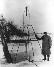American rocketry pioneer Robert H. Goddard and his first liquid-fueled rocket, March 16, 1926.