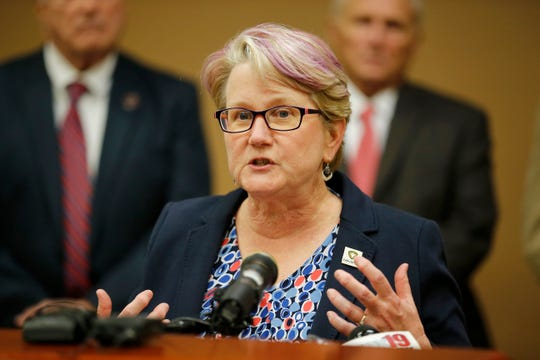 Butler County health commissioner Jennifer Bailer gives an update during a press conference at the Butler County Government Services Building in Hamilton, Ohio, on Friday, March 13, 2020. County officials announced four confirmed cases of COVID-19, and seven more individuals under observation.