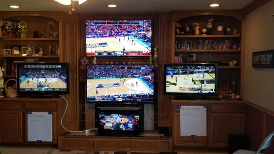 This was the setup in Tyler Reihmann's Clive house a year ago during March Madness. He won't need the five TV sets this week. The NCAA Tournament has been canceled.