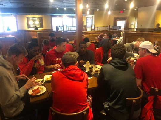 Ferris State basketball players eat at Outback Steakhouse after learning their season had been canceled.