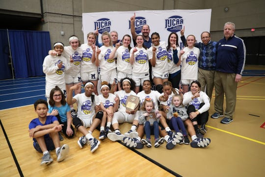 The Macomb CC women's basketball team poses for photos after defeating Mott CC on March 7 to win the Region XII East District Championship. The win put Macomb in the NJCAA national championship game, which was canceled.