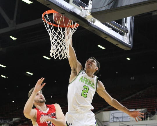 Providence's Zaccheus Darko-Kelly, shown dunking over an opponent in a game this past season, is one of 25 small college players in line for the Bevo Francis Award as top small college player of the year.