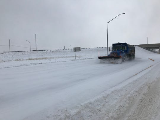 A snowplow for the city of Great Falls clears a road near Interstate 15 and the Marketplace Saturday.