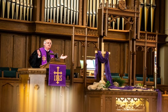 Pastor Barrie Tritle speaks during a service, Sunday, March 15, 2020, at the First United Methodist Church in Iowa City, Iowa.
