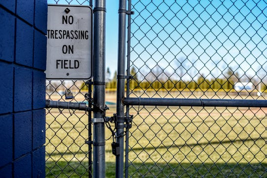 The East Lansing High School baseball field is locked on Friday, March 13, 2020, in East Lansing. The MHSAA suspended high school sporting events through at least April 5 in an effort to slow the spreading of the coronavirus.
