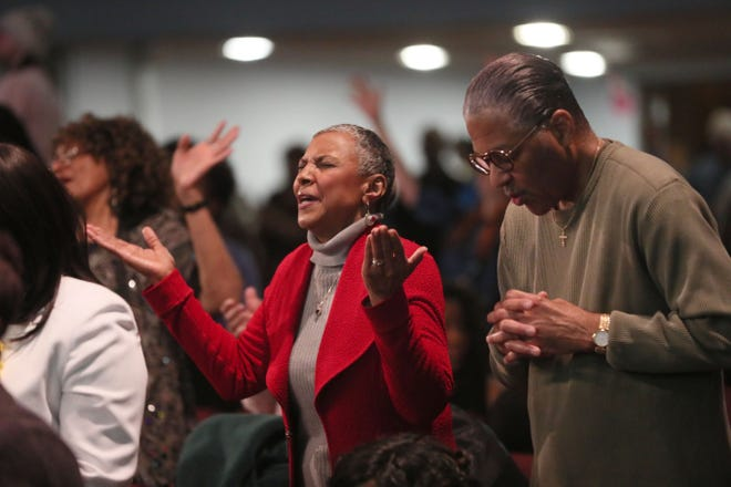 People take part in praise and worship during the service at Parklawn Assembly of God Church, 3725 N. Sherman Blvd., in Milwaukee on Sunday.