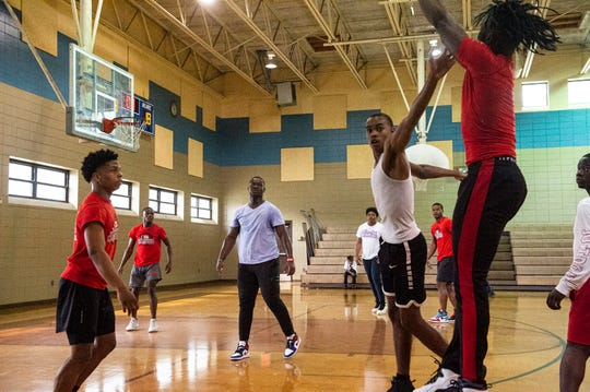 Former and current Lee basketball players play during a celebration for Lee's state championship year at Sheridan Heights Community Center in Montgomery, Ala., on Sunday, March 15, 2020.