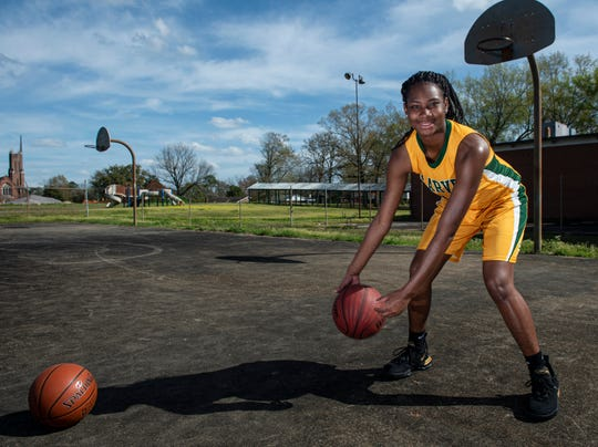 All-Metro athlete Carver's Bre'Anna Rhodes poses for a portrait in Montgomery, Ala., on Thursday, March 12, 2020.