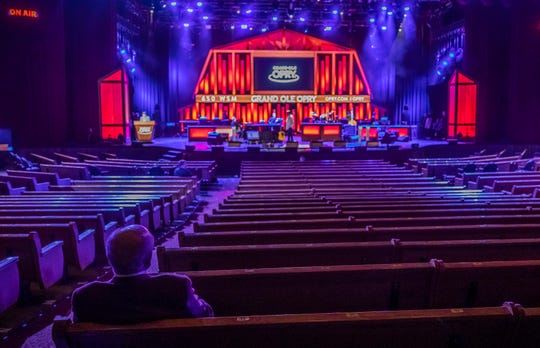 Colin V. Reed, Chairman/CEO at Ryman Hospitality Properties is the lone audience member as Bill Anderson performs during the Grand Ole Opry broadcast on WSM Radio without a live audience at The Grand Ole Opry House Saturday, March 14, 2020.
