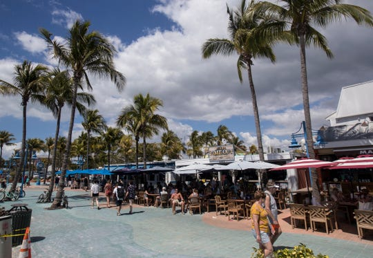 """Times Sqaure on Fort Myers Beach at 2:13 P.M. on Sunday March 15, 2020. Fort Myers Beach mayor and business owner, Anita Cereceda said """"Although business is down we still have many visitors here on the island who are supporting our local business and we are grateful to them. Hopefully, responsibily, optimistic is our strategy."""