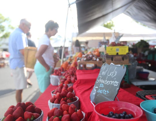 Fresh fruit and vegetables were a hot commodity at the Pine Ridge Road Farmers Market Sunday.