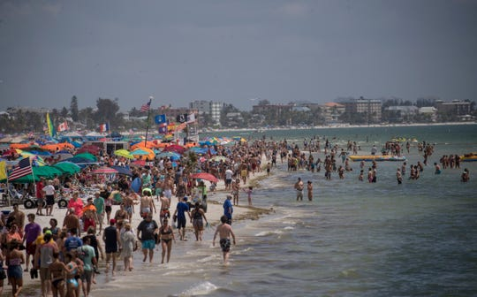 """Fort Myers Beach on Sunday afternoon March 15, 2020. Fort Myers Beach mayor and business owner, Anita Cereceda said """"Although business is down we still have many visitors here on the island who are supporting our local business and we are grateful to them. Hopefully, responsibly, optimistic is our strategy."""""""