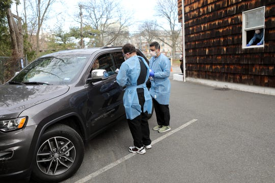 A patient is seen by medical staff at a drive-through where they test for COVID-19 at Riverside Medical Group, in Secaucus. Sunday, March 15, 2020