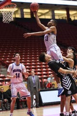 Ray Brown glides in for a lay up for Las Cruces against Capital during Saturday's Class 5A state championship game at The Pit in Albuquerque.